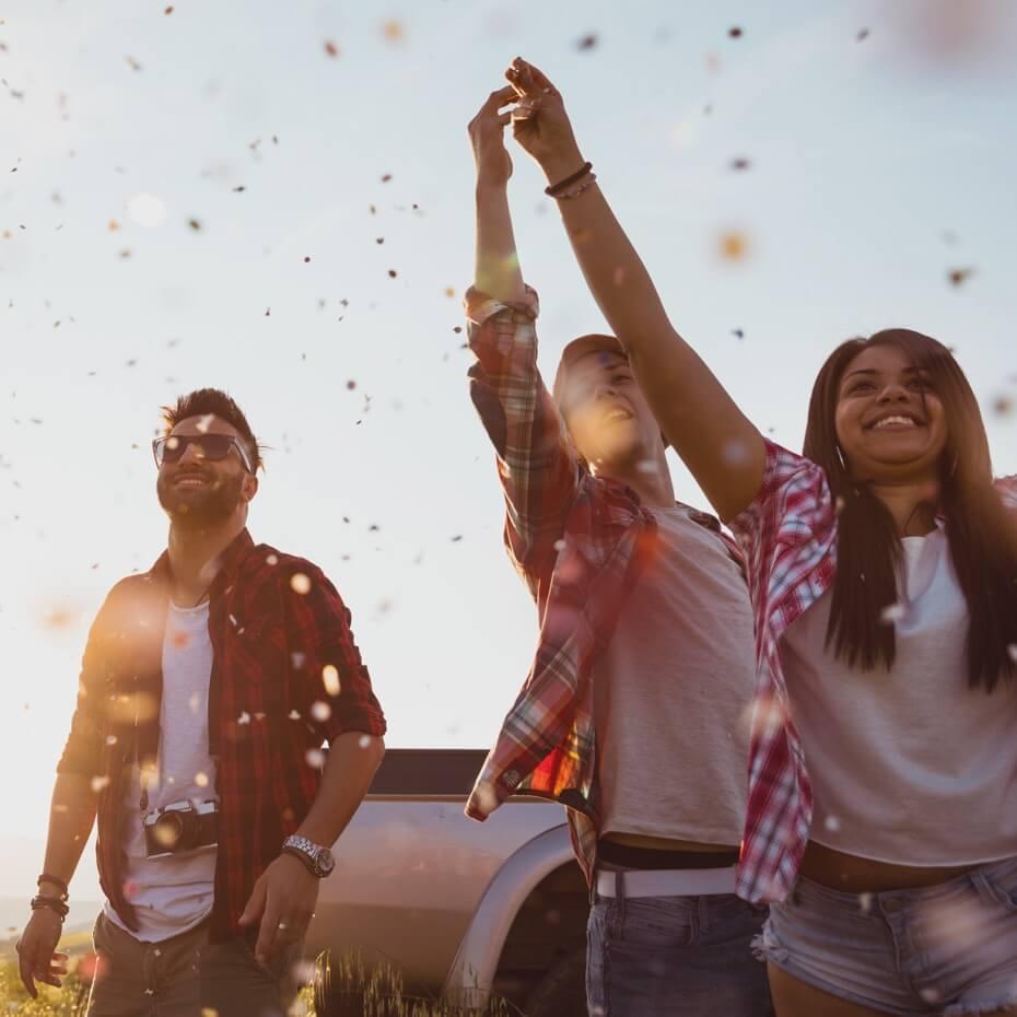 Friends throw confetti in celebration