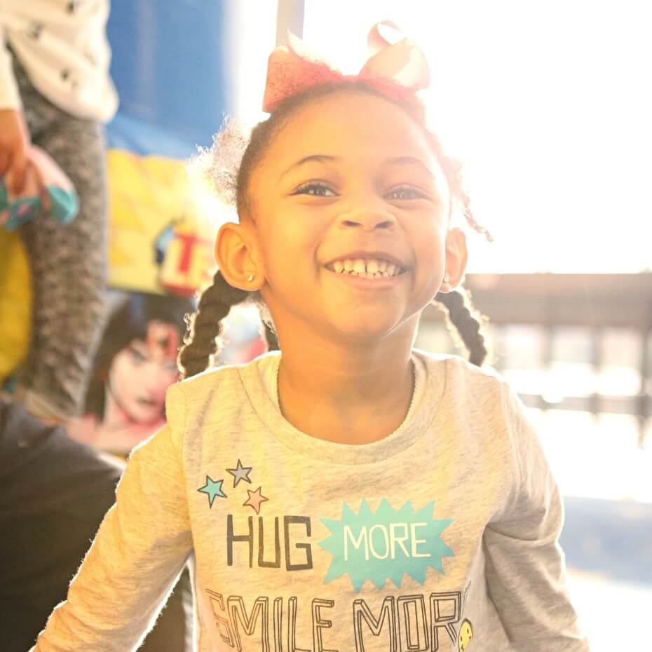 A little girl smiles during KidsLife service