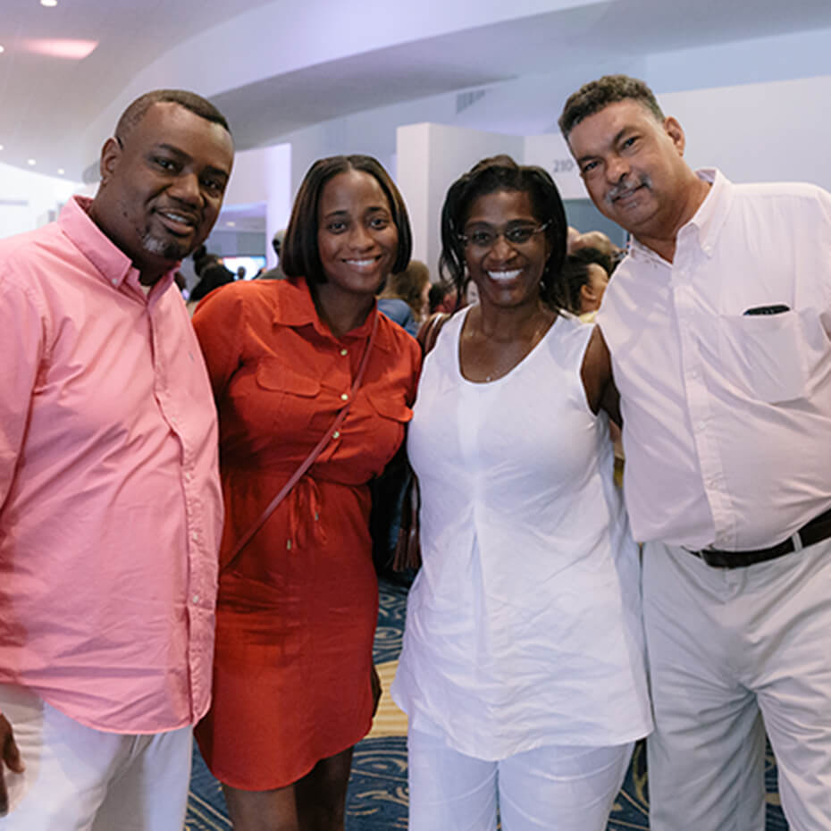 A group of couples smiling at Spark Marriage Conference
