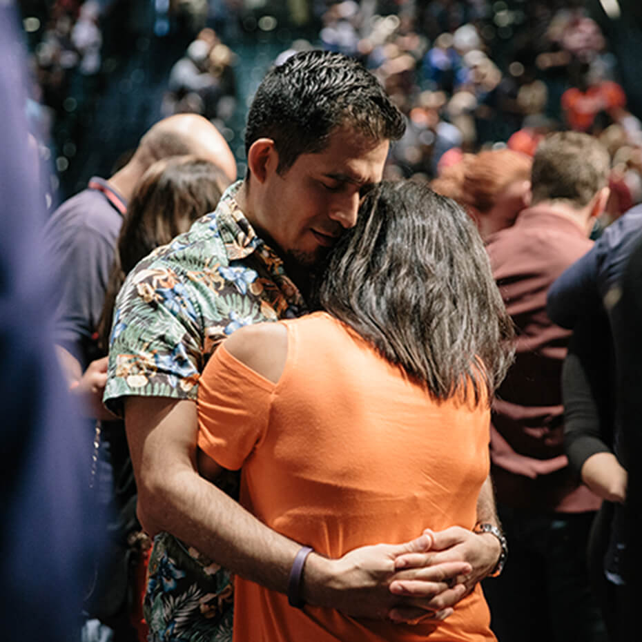 A husband and wife praying for each other at Lakewood's Spark Marriage Conference