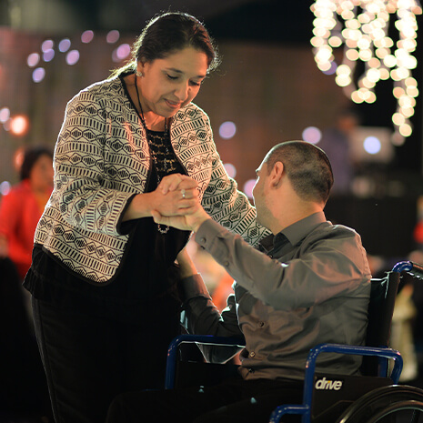 Mother and son dancing at the annual Champions Banquet