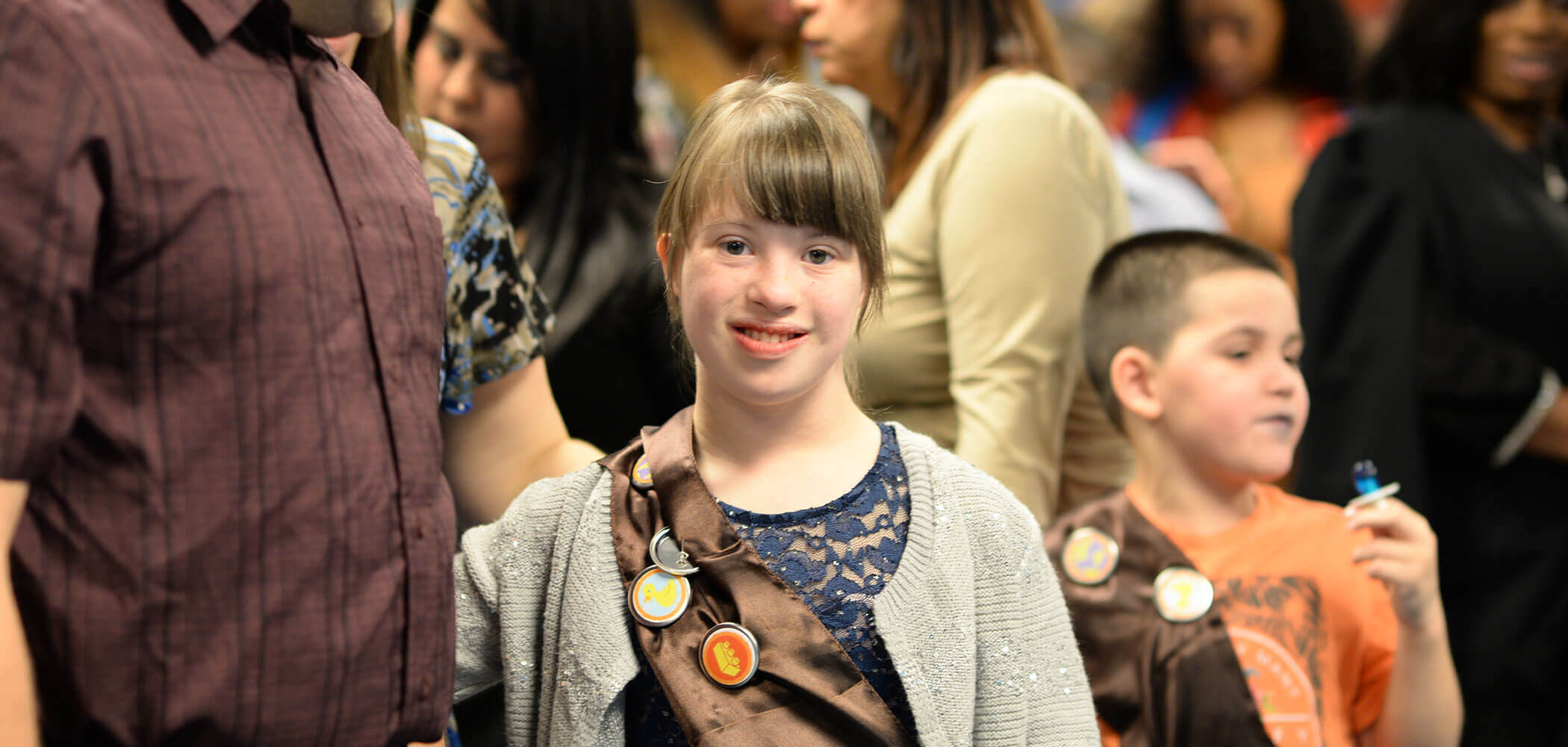 Girl smiling at Champions Club banquet