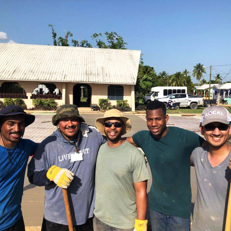 A group of men standing outside during a mission to Belize.