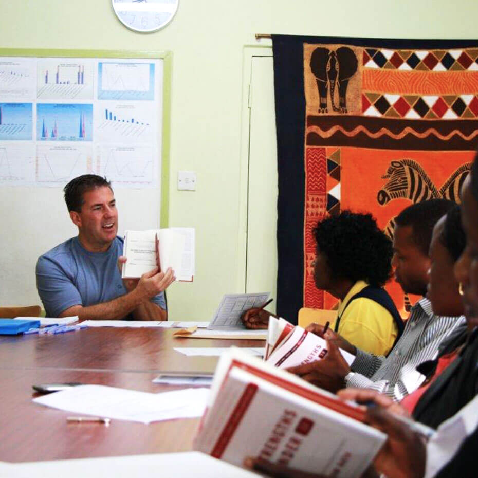 A volunteer teaches a session on Strengths Finder during a mission trip to Kenya.