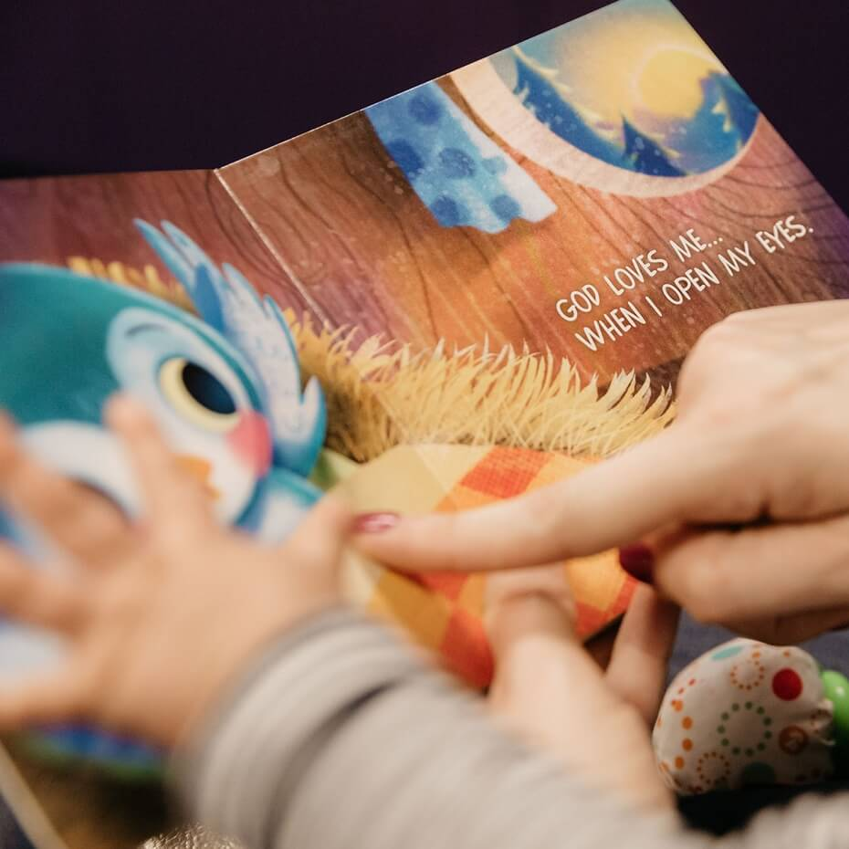 A young child is read a book about God's love.
