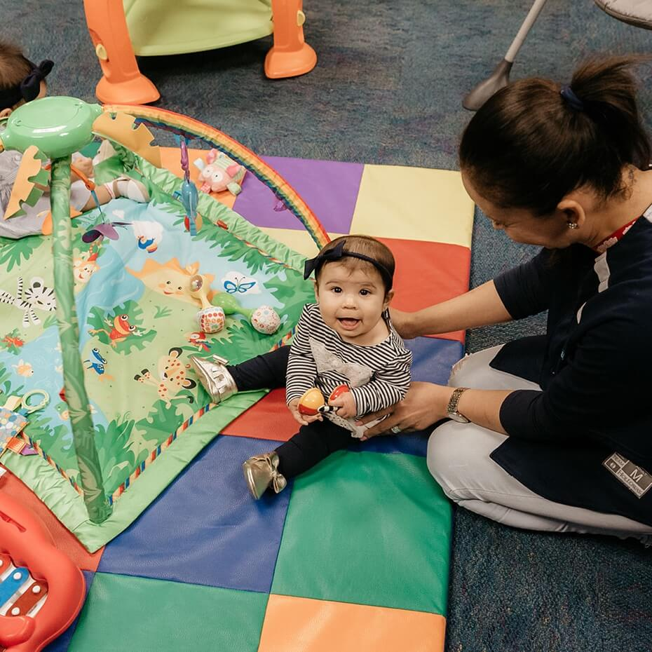 A happy baby enjoying her supervised playtime.