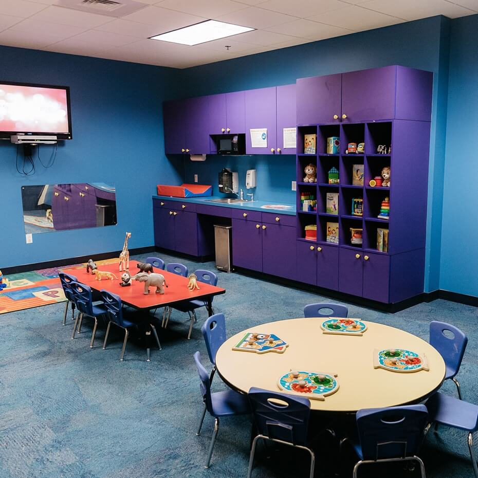 The classroom for 2 year olds set and organized for a day of learning and play.