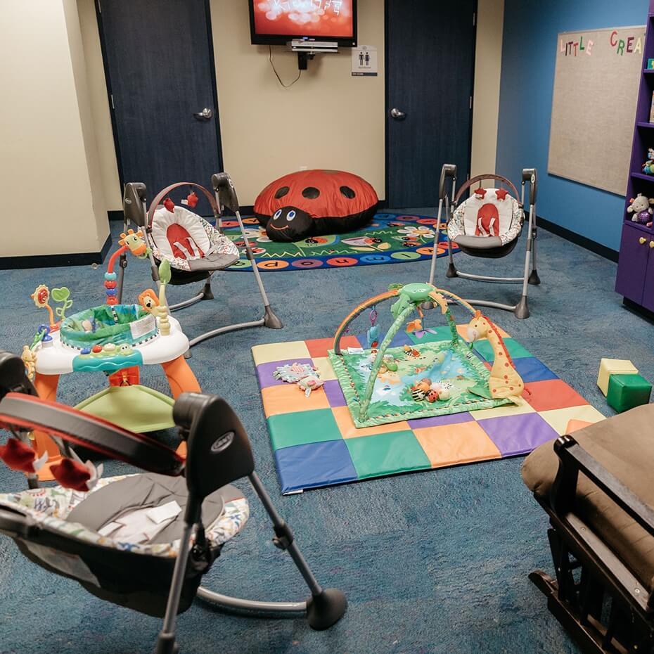 The empty classroom set up and ready for our youngest KidsLife baby members.