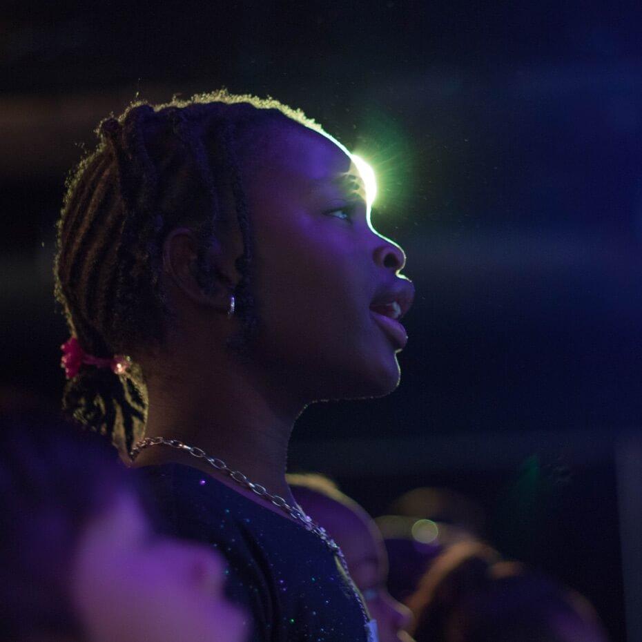 A young girl singing during KidsLife worship.