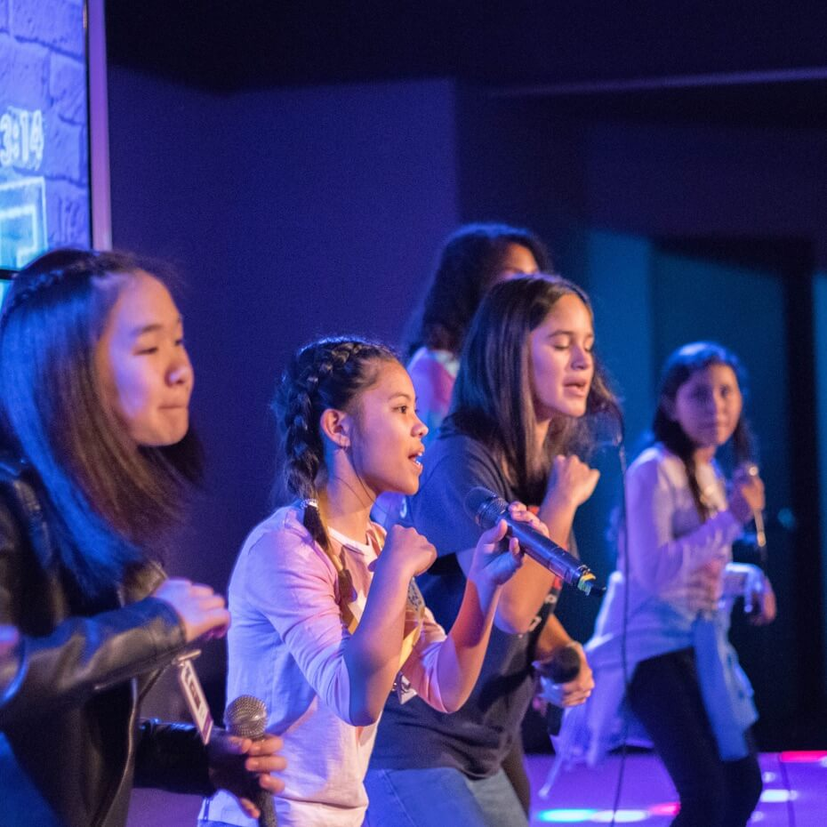 A group of kids leading worship during a KidsLife service