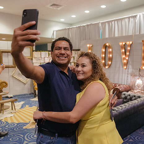A couple snaps a selfie at the Spark Marriage Conference at Lakewood Church