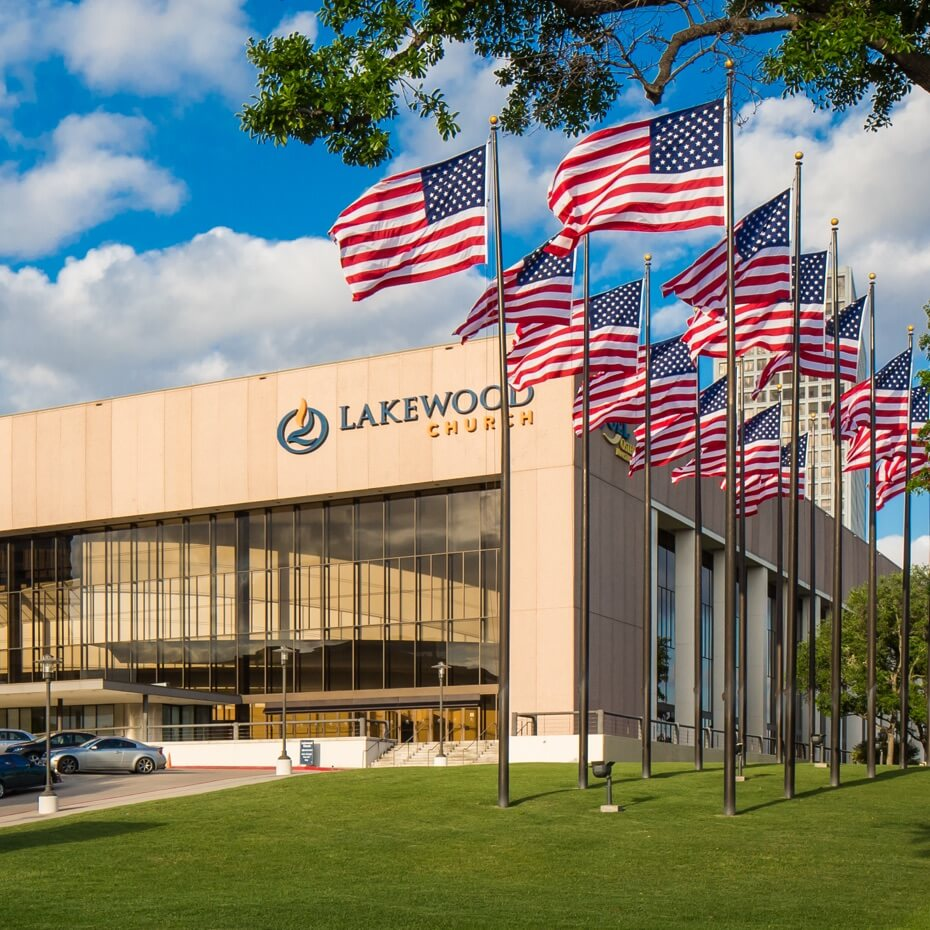 Exterior of Lakewood Church with USA flags