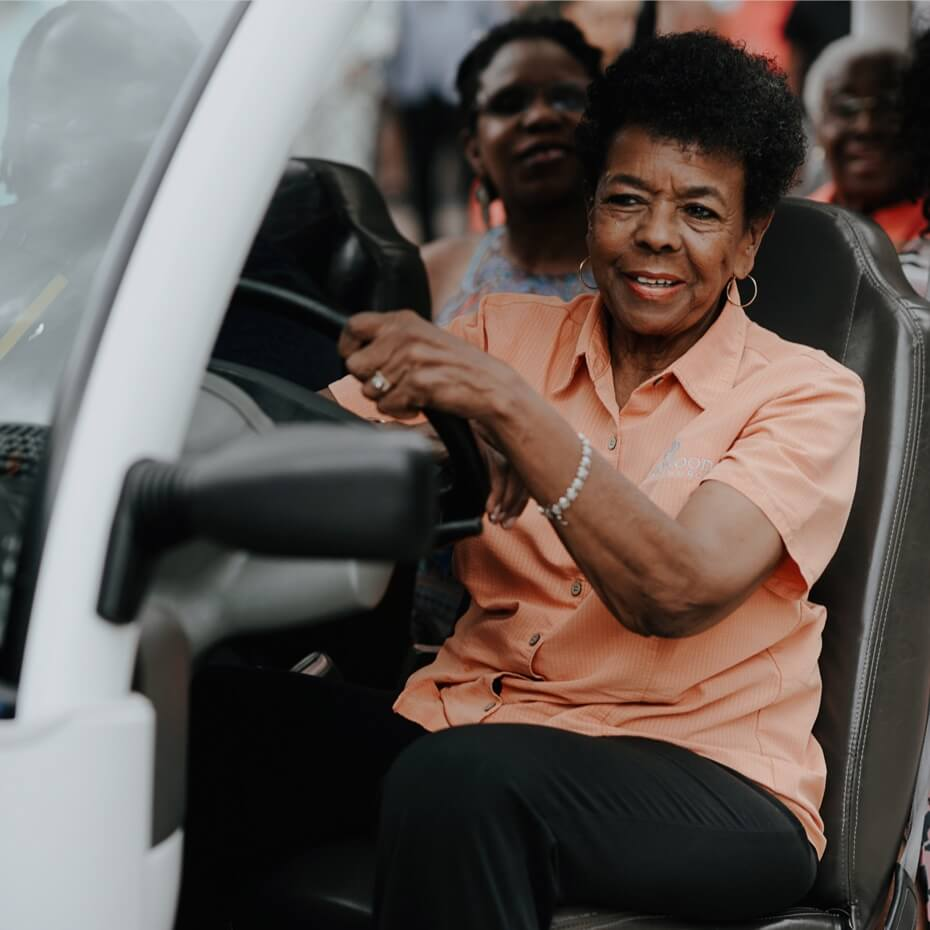 A smiling driver and passengers